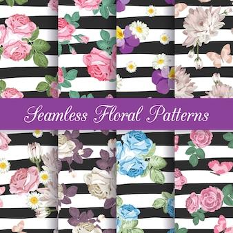 Stel verzameling van naadloze patronen met bloemen op zwart-wit gestreepte achtergrond