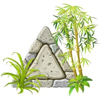 Stenen bord met bamboe takken