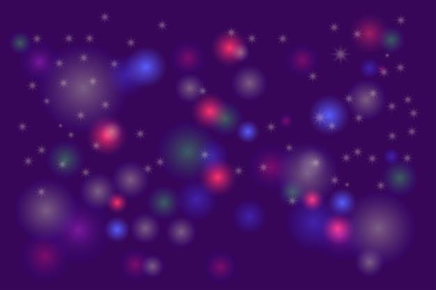Sterren op paarsblauwe bokehachtergrond voor gelukkige nieuwjaarsviering of speciale verjaardagsdag