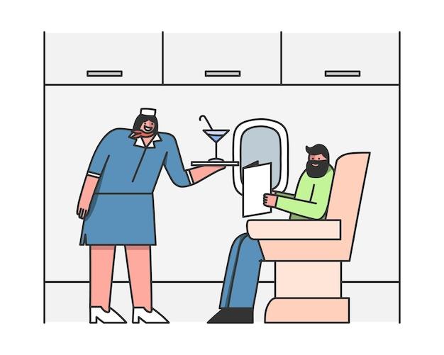 Stewardess serveert passagier in vliegtuig stewardess biedt drankjes aan