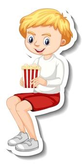 Stickerontwerp met karakter van een jongen die popcorn zit te eten