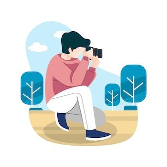 Stijl van jonge fotograaf op het werk met casual kleding