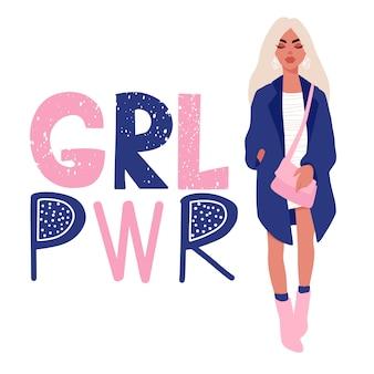 Stijlvol mooi meisje in mode kleding met tas en inscriptie girl power.