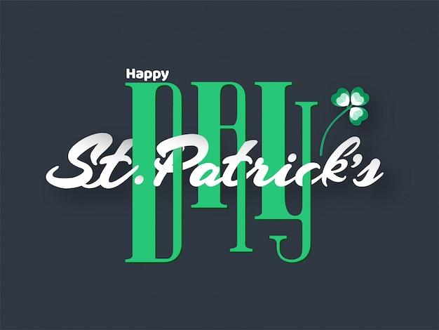Stijlvolle creatieve tekst van happy st. patrick's day met shamrock leaf op grijs.