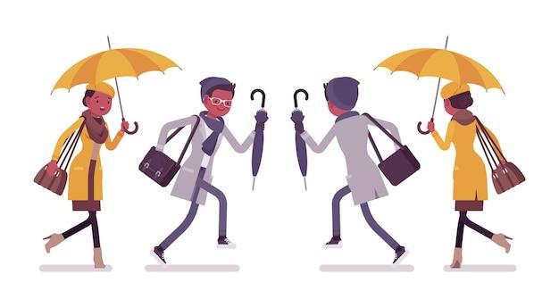 Stijlvolle jonge zwarte man en vrouw met paraplu met illustratie