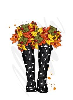 Stijlvolle rubberen laarzen met herfstbladeren