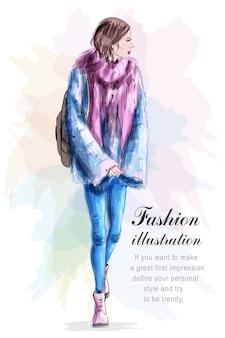 Stijlvolle vrouw in mode kleding met rugzak en sjaal