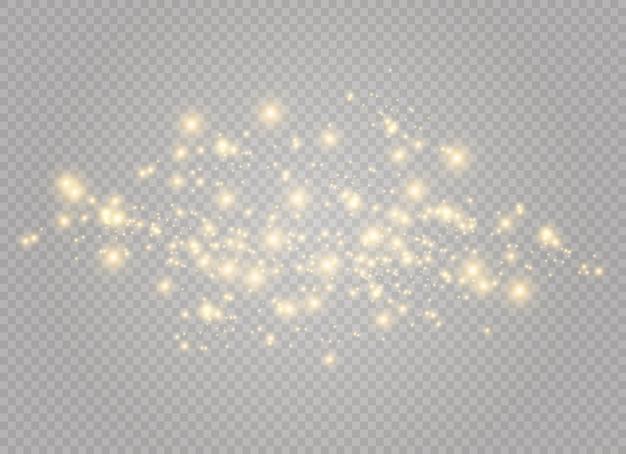 Stofgeel. gele vonken en gouden sterren schijnen met speciaal licht. schittert op een transparante achtergrond. kerst abstract patroon. sprankelende magische stofdeeltjes.