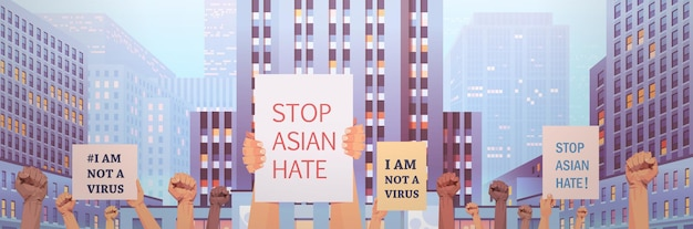 Stop aziatische haat. menselijke handen met posters tegen racisme. ondersteuning tijdens covid-19 coronavirus pandemie