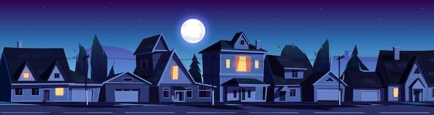 Straat in voorstad met huizen 's nachts