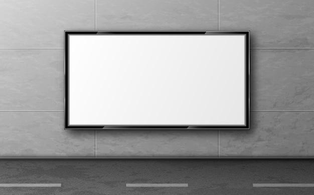 Straatreclame voor advertentie, displaymodel hangt aan een grijze betegelde muur langs de weg