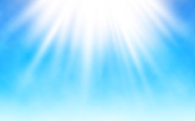 Stralende zon op blauwe hemel.