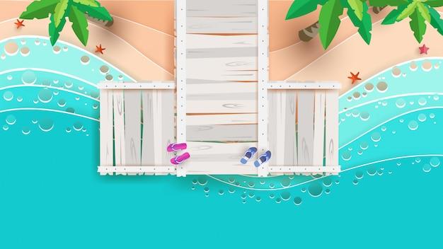Strandtafereel vanaf de top in de zomer met bruggen in papierkunst