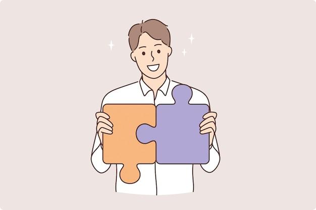 Strategie, carrière en ontwikkelingsconcept. jonge lachende man stripfiguur maken puzzelstukjes samen zelfverzekerd gevoel vectorillustratie