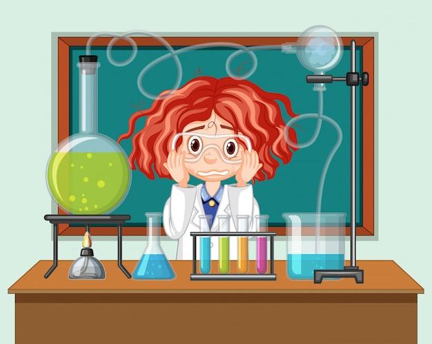 Student in wetenschapsklaslokaal die met hulpmiddelen werken