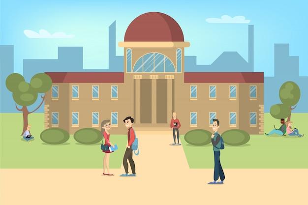 Studenten die en dichtbij universiteit in park ontspannen bestuderen.