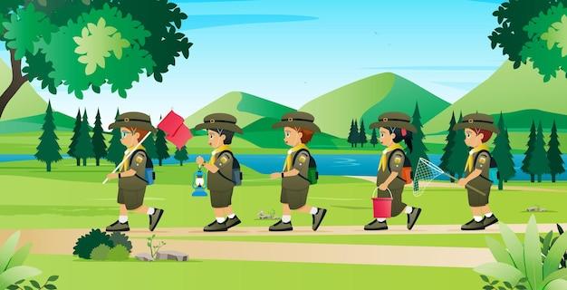 Studenten in het scout-uniform leren leven in de natuur