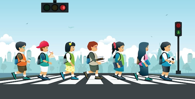 Studenten lopen op een zebrapad met verkeerslichten.