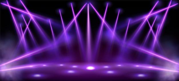 Studio met stage lights spotlight balken met rook Gratis Vector