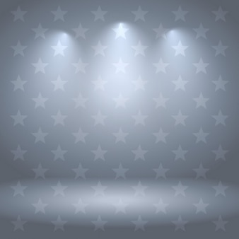Studio van de grijze achtergrond met sterren en verlichting