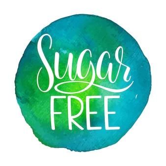Suikervrije kalligrafie. met de hand getekend etiket. suikervrij teken op een blauwe en groene aquarelachtergrond