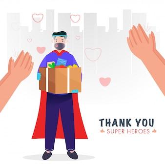 Superheld bezorger met beschermend masker met gezichtsschild, kruidenierdoos houden en handen klappen om te waarderen op witte stadsgezicht achtergrond.
