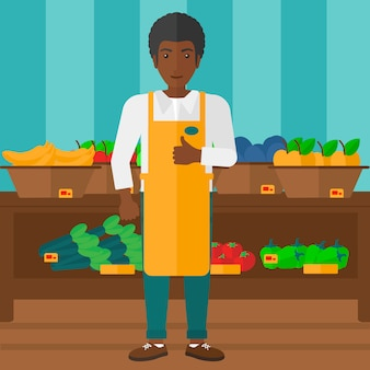 Supermarkt werknemer met doos vol appels