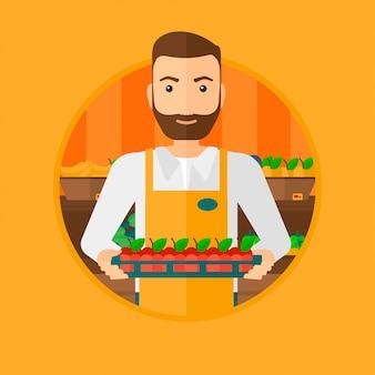 Supermarktwerknemer met dooshoogtepunt van appelen.