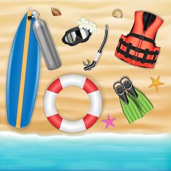 Surfplank en duikgereedschappen op zee strand