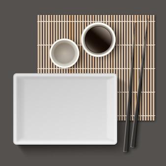 Sushigereedschap dat met de illustratie van de bamboemat wordt geplaatst