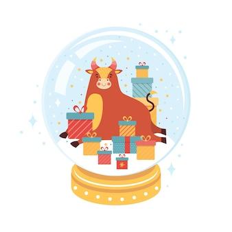 Symbool van het nieuwe jaar is een stier in een glazen kerstbal.