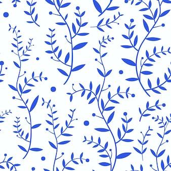 Takken met blauwe bladeren op wit patroon als achtergrond