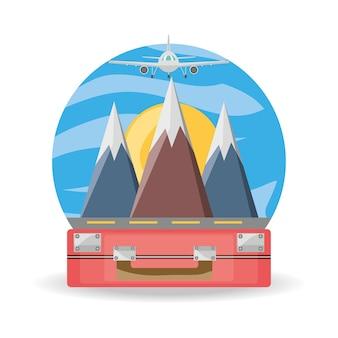 Tas en vliegtuig met besneeuwde bergen