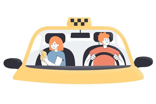 Taxichauffeur en vrouwelijke passagier achter voorruit