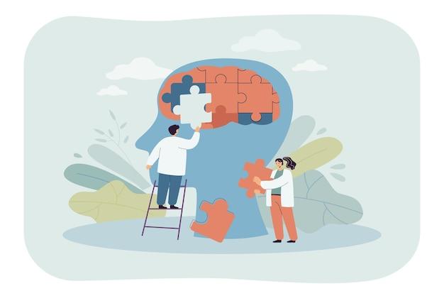 Team van artsen die puzzelstukjes van het hoofd van de persoon in elkaar zetten