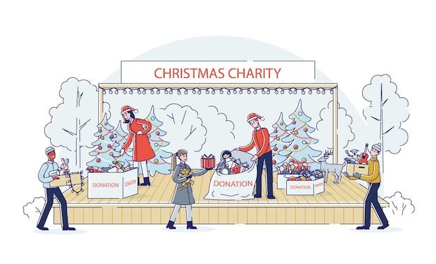 Team van vrijwilligers dat donaties inzamelt voor kerstliefdadigheid voor arme kinderen