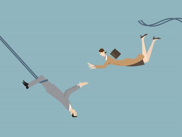 Teamwork uitdaging concept. een zakenman die een vliegende zakenvrouw vangt als een trapeze-artiest.