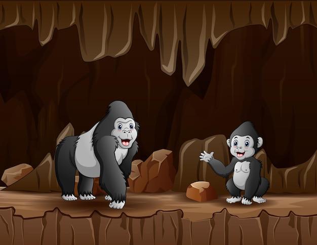 Teken een gorilla met haar welp in de grot