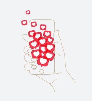 Telefoon in de hand met veel soortgelijke symbolen