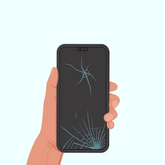 Telefoon met een gebarsten scherm in een hand