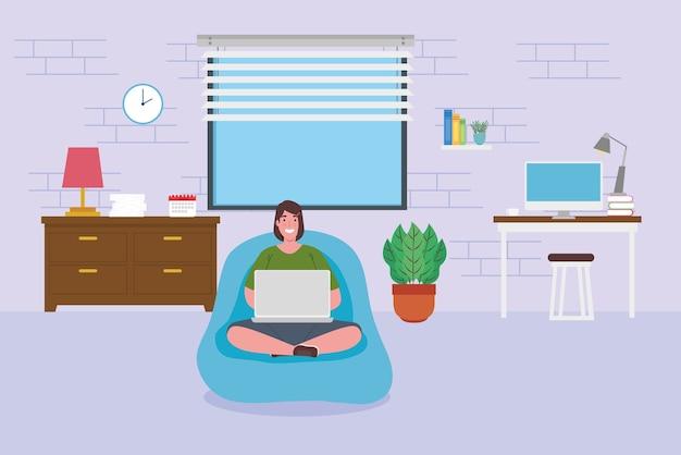 Telewerken, vrouw zitten in poef met laptop, werken vanuit huis.