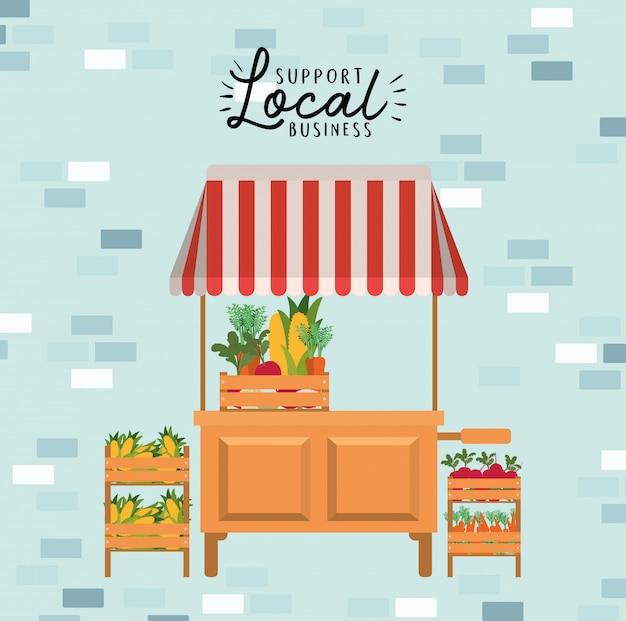 Tent met groenten in dozen en ondersteuning van lokale zaken