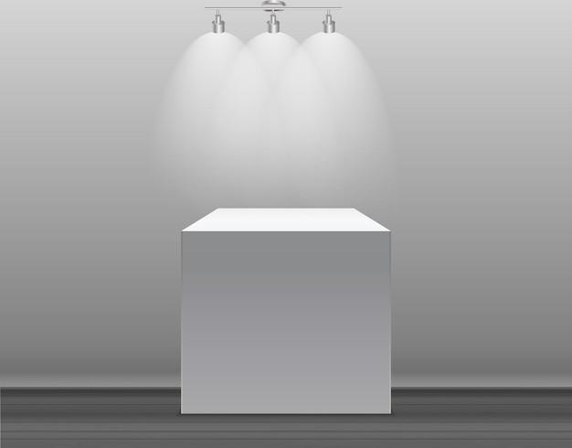 Tentoonstellingsconcept witte lege doosstandaard met verlichting op grijze achtergrond