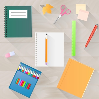 Terug naar school. een set briefpapier met een lange schaduw. bovenaanzicht van het bureaublad.