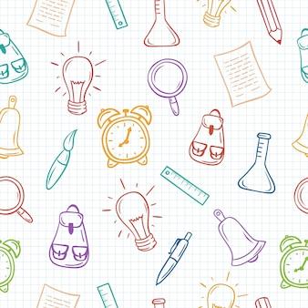 Terug naar school hand getrokken kleurrijke naadloze patroon op ruitjespapier.