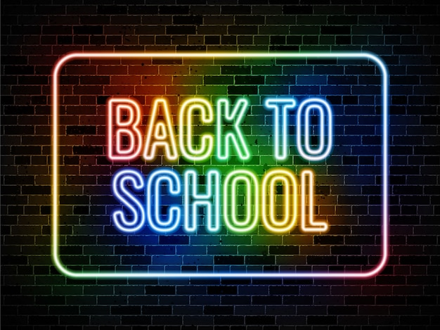 Terug naar school neon teken op donkere bakstenen muur achtergrond
