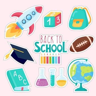 Terug naar school onderwijs hand getekende set. plakboek set. sticker. met hoed afgestudeerd, scroll, appel, boeken, kolven, basketbal, wekker, aktetas, rugzak, schoolbus, wereldbol, liniaal