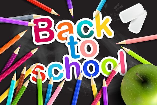 Terug naar school. regenboogpotloden, gum en groene appel op een schoolbord.