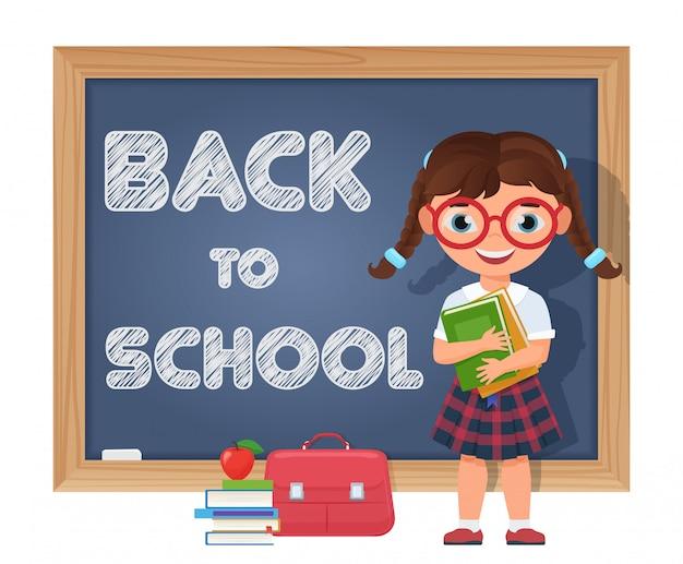 Terug naar school. schoolmeisje in de buurt van schoolbord