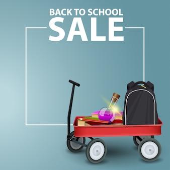 Terug naar school verkoop banner vierkant met copyspace en kar vol schoolbenodigdheden
